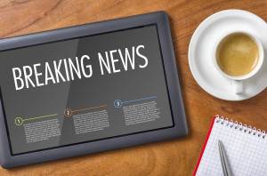 Tablet on a wooden desk - Breaking News
